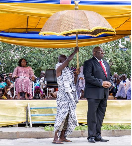 Dele Momodu under umbrella