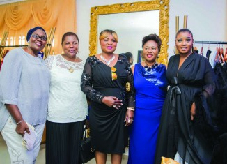Designer flanked by her mom and friends