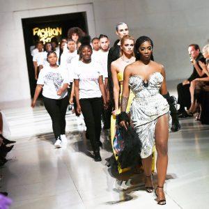 Tiwa Savage walks the runway for Naomi Campbell's