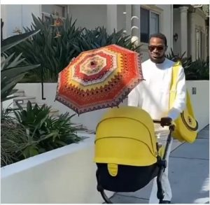 Singer, D'banj steps out with new born son (photos)